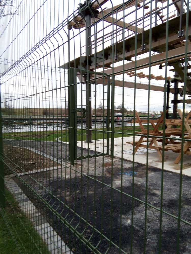 2.43m High crimped mesh panel with pedestrian gate, Teesside.