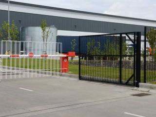 2.40m High Paladin FX Entrance C/W Rising Arm Barrier with double skirt at Clipper Logistics, Wynyard Park, North East.