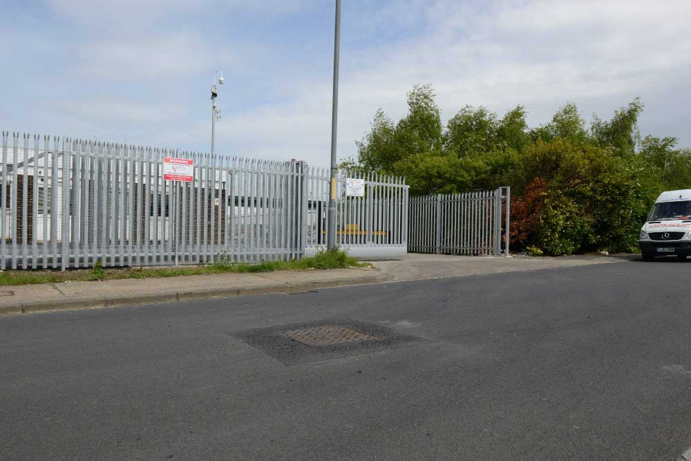 Galvanised palisade with sliding gate