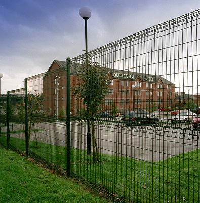 Roll top mesh panel perimeter fencing.