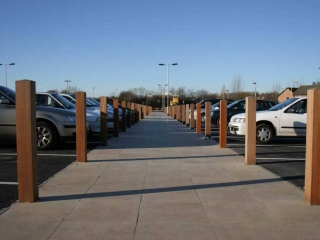 Timber bollards installed at Supermarket car park at Teesside to provide demarcation of pedestrian walkway. — at Teesside.