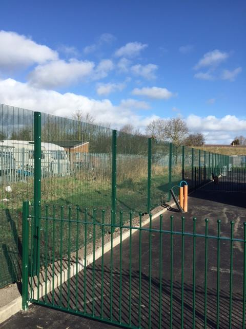 2.40m High Green 358 Mesh panel fence erected around a travellers site in Hurworth for Darlington Borough Council.
