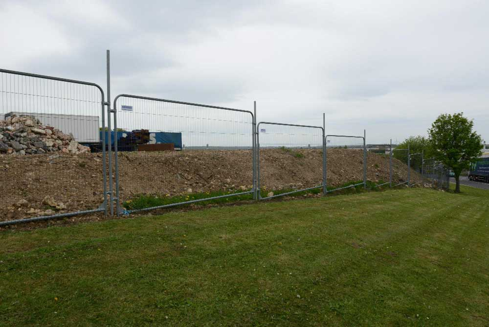 temporary fencing protecting groundworks.