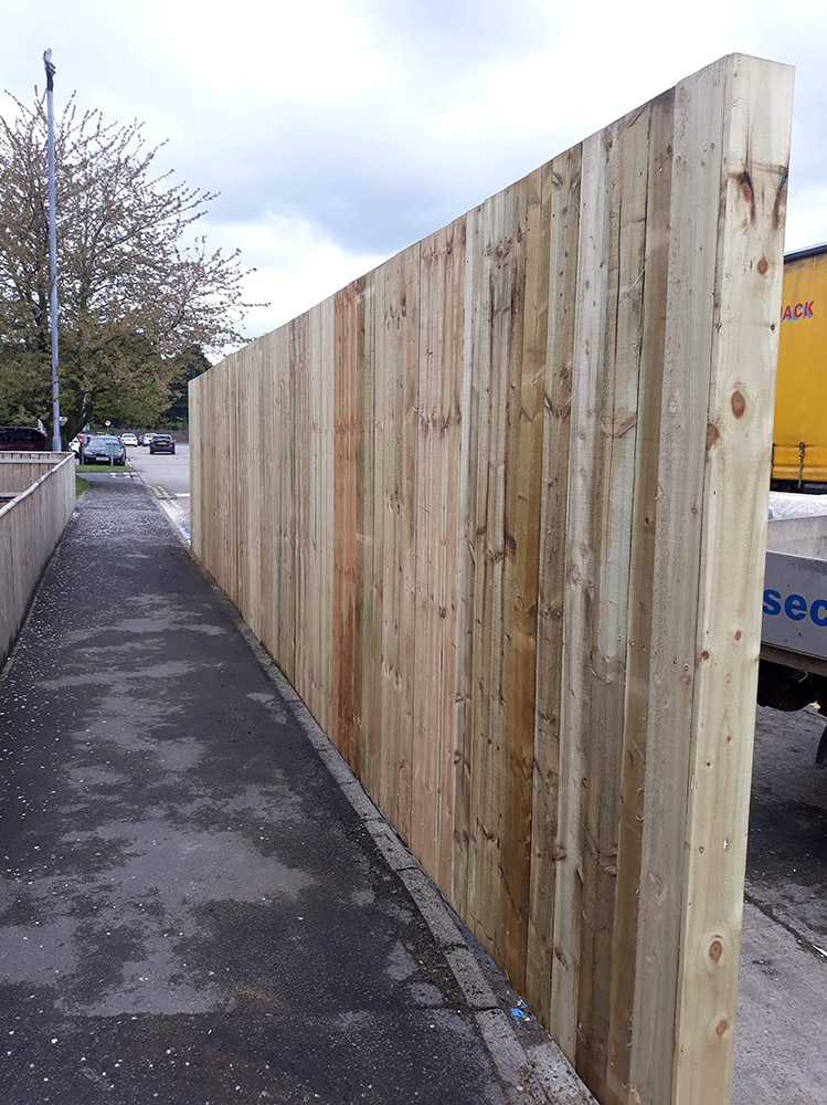 2.4m High Timber close boarded fence, with RSJ posts baseplated posts, and box section horizontal rails