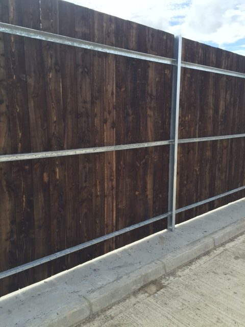 Timber clad palisade post and rails