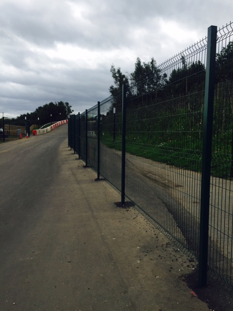 Securing the site at Kynren with crimped mesh fencing