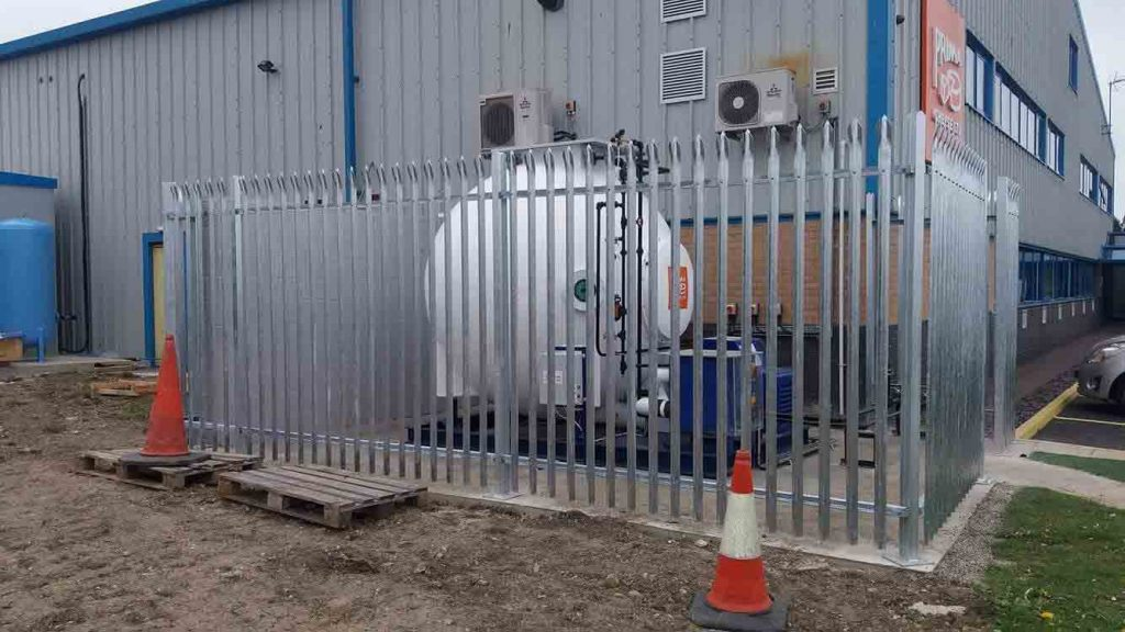 Steel palisade compound protects storage tank