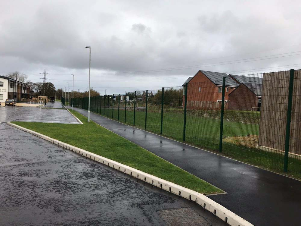 Installation of the Nylofor 2d (656) perimeter fencing on a gentle incline