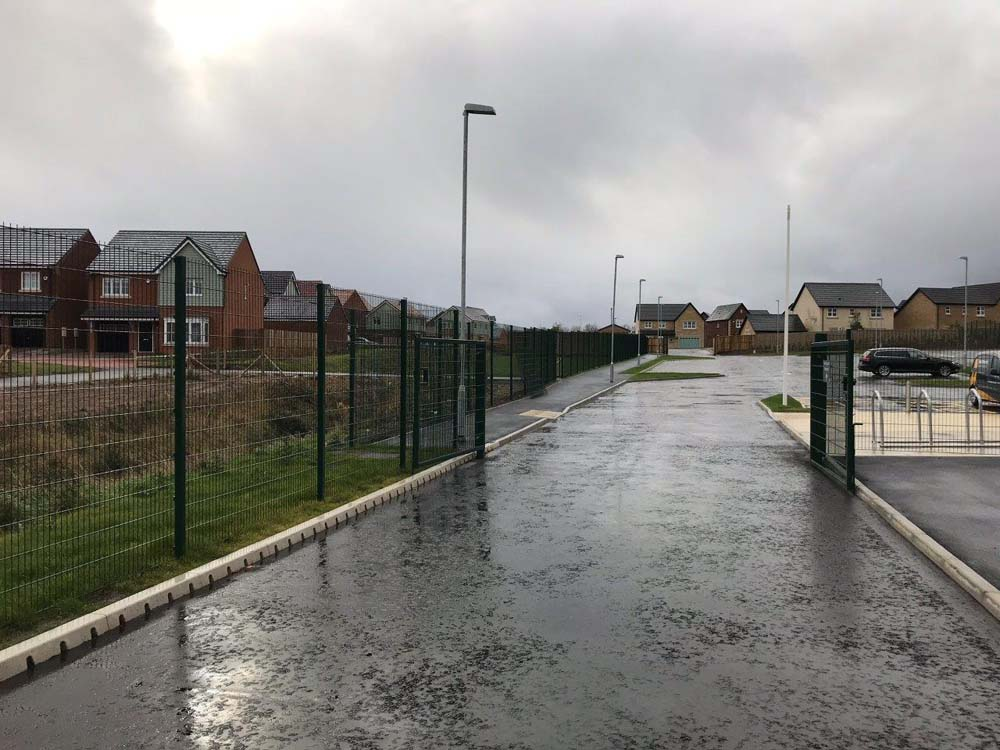 Double leaf swing gates manufactured by Rennyco using Nylofor 2d (656) mesh panel insert to match the perimeter fencing