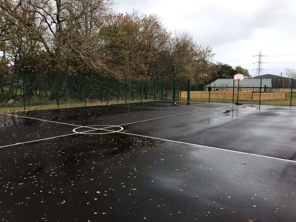 Ball court perimeter fencing with timber Jacksons playtime fence in the background